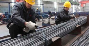 GANYU, CHINA - APRIL 01:  (CHINA OUT) Two employees tie up steel bars at a steel-making plant on April 1, 2013 in Ganyu, China. China's Purchasing Managers Index (PMI) rose to 50.9 percent in March from 50.1 percent in February, according to the National Bureau of Statistics (NBS).  (Photo by ChinaFotoPress/ChinaFotoPress via Getty Images)